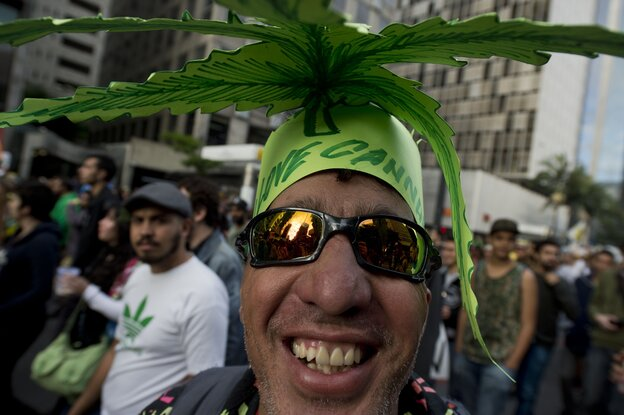 People smoke marijuana, presumably, because it affects their brains, not despite that fact. Above, people in Sao Paulo, Brazil, campaign for the legalization of marijuana.