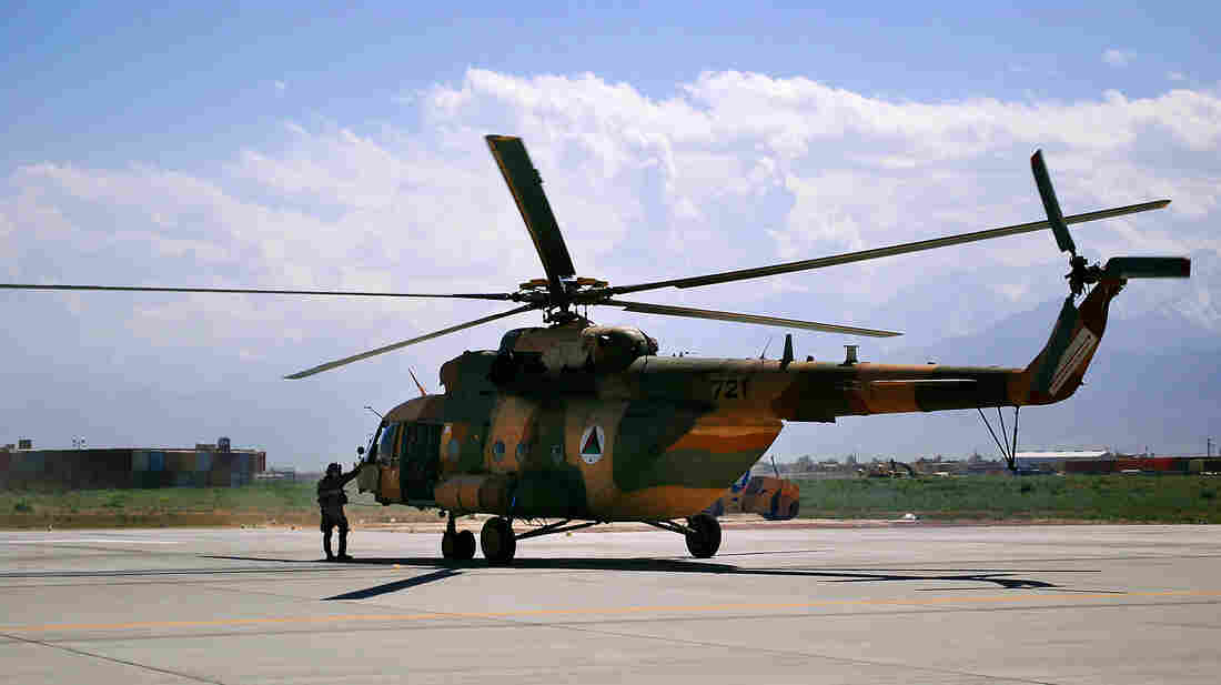 An Mi-17 helicopter used by the Afghan air force sits on Bagram Air Field in Afghanistan in May 2013. The Pentagon purchases the Russian-made helicopters for the Afghan air force, but recent sanctions may put that deal in jeopardy.
