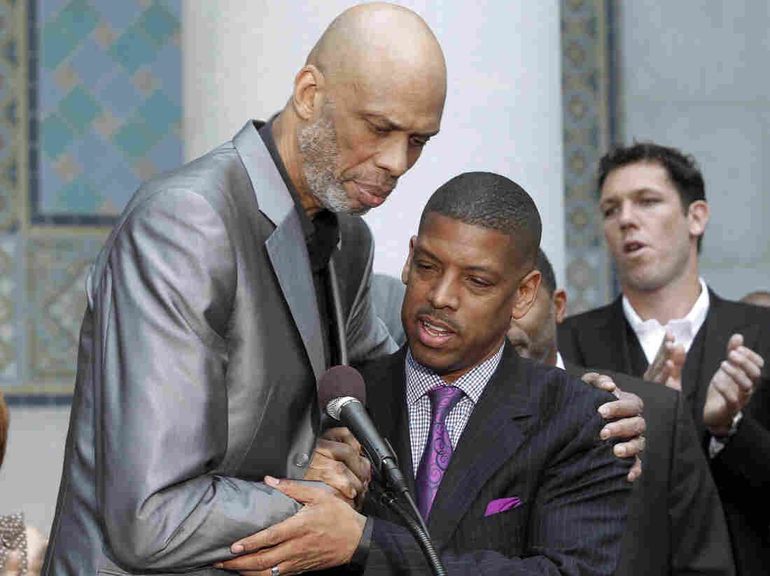Hall of Famer Kareem Abdul-Jabbar embraces Sacramento Mayor Kevin Johnson during a news conference on Tuesday after NBA Commissioner Adam Silver banned LA Clippers owner Donald Sterling from basketball for life.