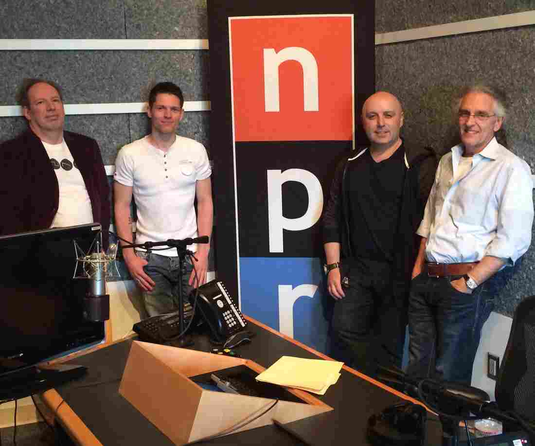 Hans Zimmer (far left) visits the studios of NPR West with (left to right) contest winner Daniel Suett, Bleeding Fingers CEO Russell Emanuel and Chairman Steve Kofsky.