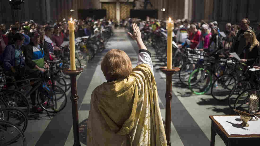 The Rev. Canon Julia Whitworth leads the 16th Annual Blessing of the Bikes at Cathedral Church of St. John the Divine on Saturday in New York City.