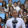 An audience, mostly women, listen behind President Barack Obama in Oct. 2012 as he speaks about the choice facing women in the election during a campaign event at George Mason University in Fairfax, Va.