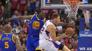 L.A. Clippers forward Blake Griffin shoots in the lane during his team's win over the Golden State Warriors in Game 7 Saturday night. The Clippers won 126-121.