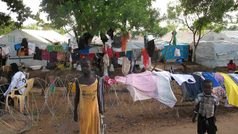 In the Tomping United Nations base in Juba, South Sudan, roughly 20,000 people live under tents and plastic tarps.