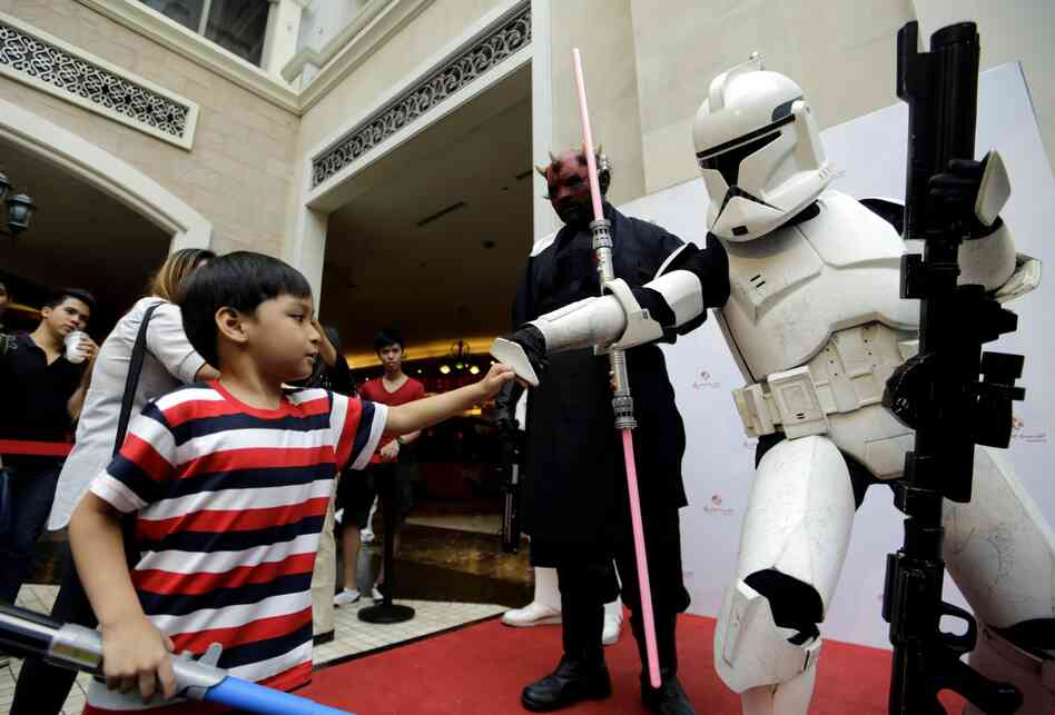 Philippines: A boy bumps fists with a clone trooper as they celebrate Star Wars Day in Pasay City, Metro Manila, Sunday.