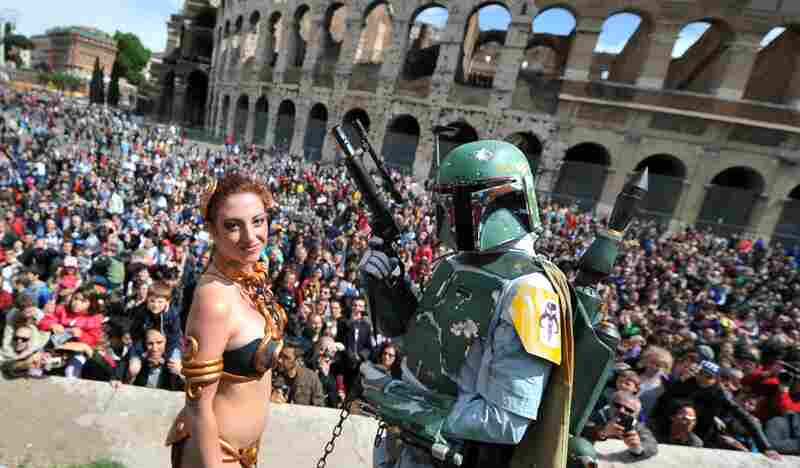 Italy: A woman dressed as Princess Leia and a man dressed as Boba Fett pause in front of the Colosseum in central Rome Sunday.