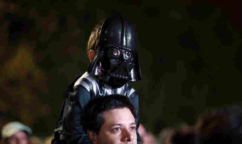 Argentina: A boy wears a Darth Vader mask as he awaits the Star Wars Run race in Buenos Aires on Saturday.