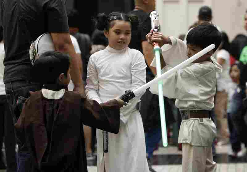 Philippines: Costumed children play with their light sabers inside a Manila-area mall for Star Wars Day.