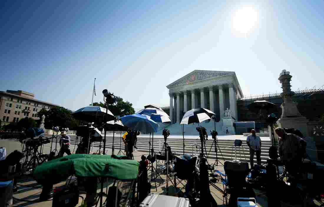 Members of the media camp outside the U.S. Supreme Court in June