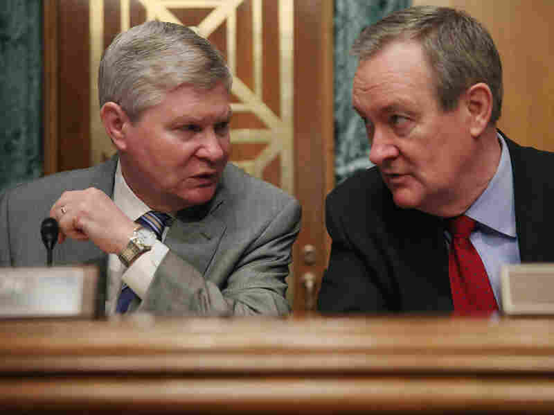 Senate Banking Committee Chairman Tim Johnson, D-S.D., (left) and ranking member Sen. Mike Crapo, R-Idaho, are proposing a major overhaul of the U.S. mortgage market.