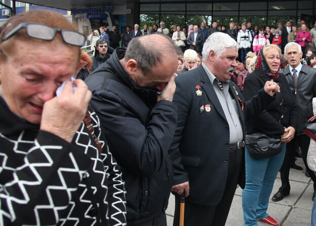 People in Odessa mourned during Monday's funeral ceremony for Vyacheslav Markin, deputy of Odessa's regional council and a leader of the pro-Russian opposition, who died in clashes Friday in the southern Ukrainian city.