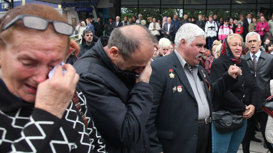 People in Odessa mourned during Monday's funeral ceremony for Vyacheslav Markin, deputy of Odessa's regional council and a leader of the pro-Russian opposition, who died in clashes Friday in the southern Ukrainian city. (AFP/Getty Images)