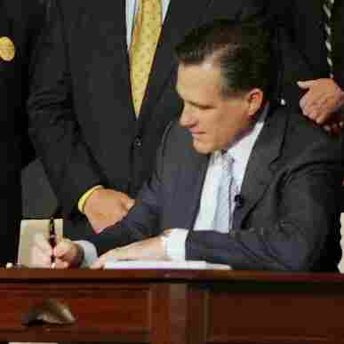 Massachusetts Gov. Mitt Romney signed a health care reform bill during an April 12, 2006, ceremony at Faneuil Hall in Boston. The bill made Massachusetts the first state in the country to require that all residents have health insurance.