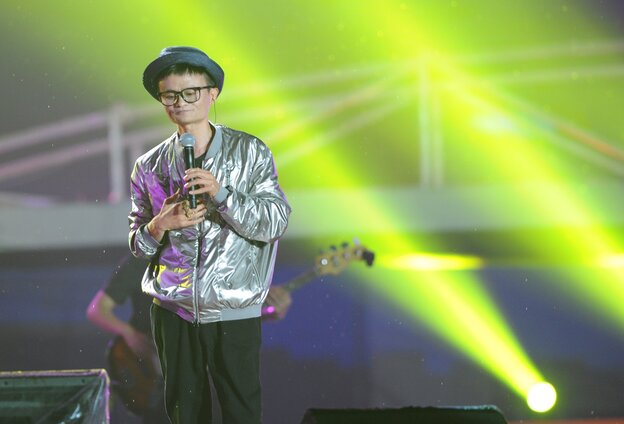 Alibaba founder Jack Ma dresses as a pop star and sings at an event to mark the 10th anniversary of China's most popular online s