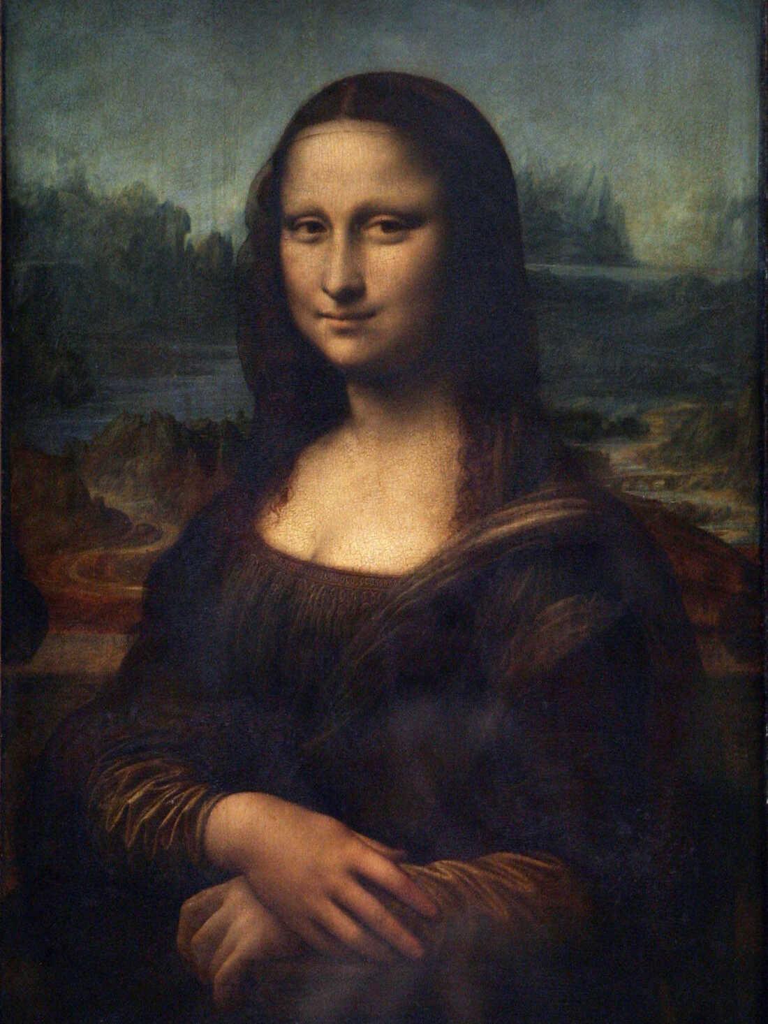 The Mona Lisa by Italian artist Leonardo da Vinci, at the Louvre museum in Paris.