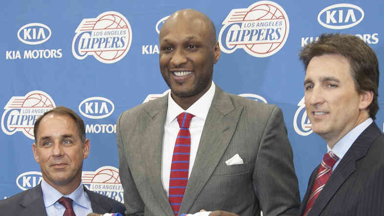 LA Clippers President Andy Roeser (left) with forward Lamar Odom (center) and head coach Vinny Del Negro in July 2012.
