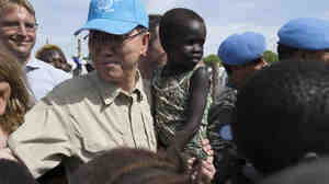 U.N. Secretary-General Ban Ki-moon holds a child at a refugee camp in Juba, South Sudan, on Tuesday. There have been increased calls for a contingent of African troops to be involved in peacekeeping operations.