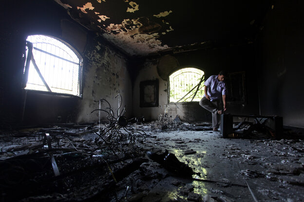 A Libyan man is shown inside the U.S. Consulate in Benghazi, Libya, after an attack that killed four Americans, including Ambassador Chris Stevens, on Sept. 11, 2012.