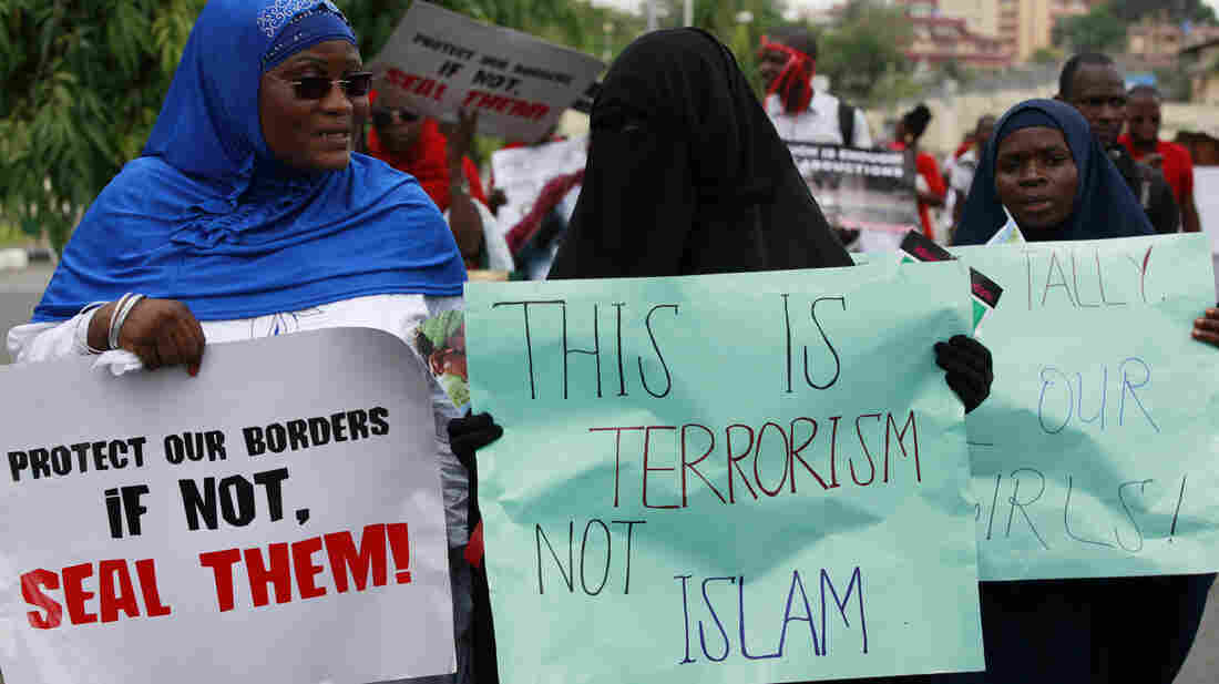 Muslim women march as part of a call for Nigeria's government to increase efforts to rescue more than 200 girls who were kidnapped from their school last month.