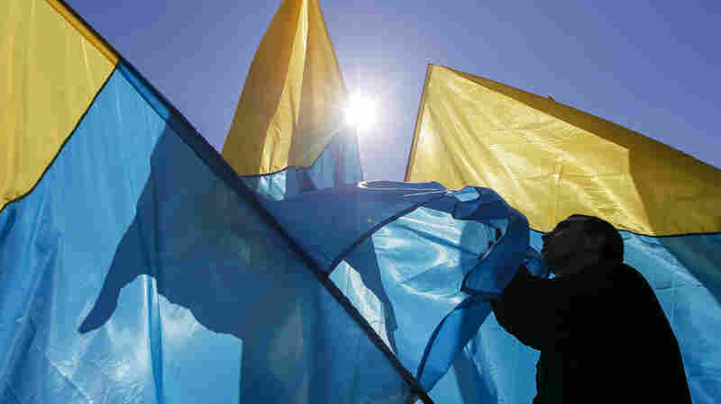An activist waves the Ukrainian national flag at Independence Square on April 6.