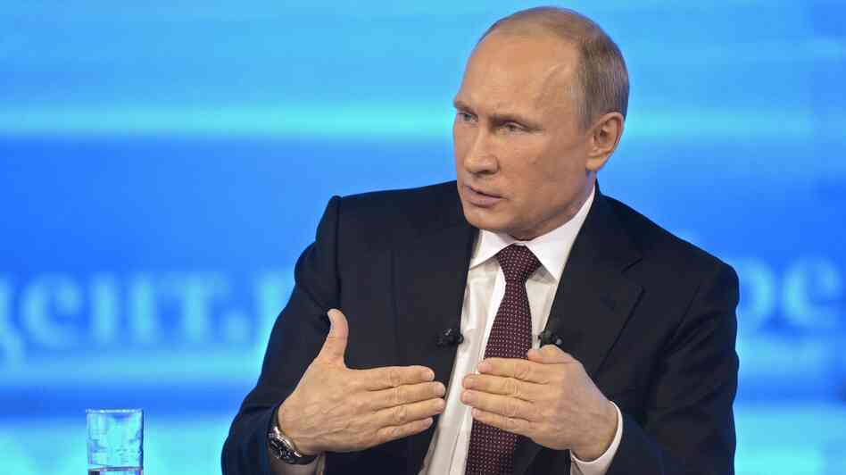 Russian President Vladimir Putin, shown speaking on TV last month, has signed a measure that would impos