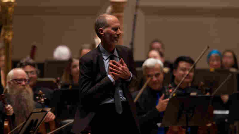 Composer John Luther Adams accepts enthusiastic applause from the Carnegie Hall audience after the New York premiere of his 2014 Pulitzer Prize-winning piece, Become Ocean, performed by the Seattle Symphony Orchestra.