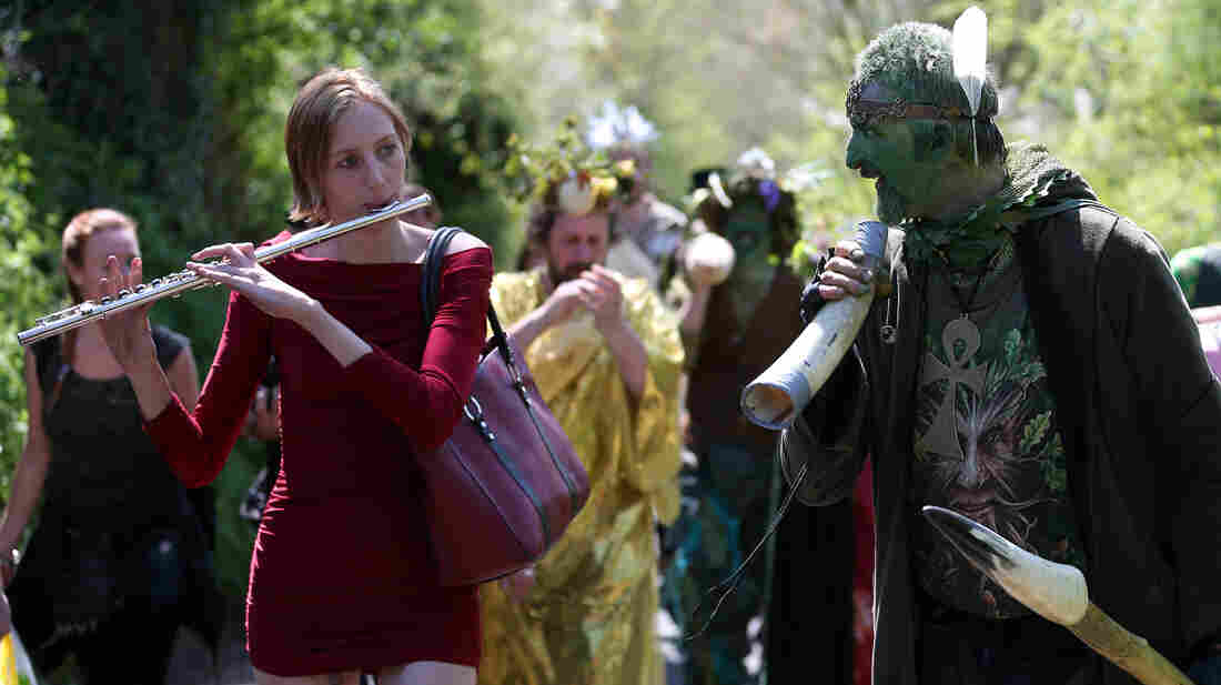 A man painted green takes part in a Beltane May Day celebration on May 1, 2013 in Glastonbury, England.