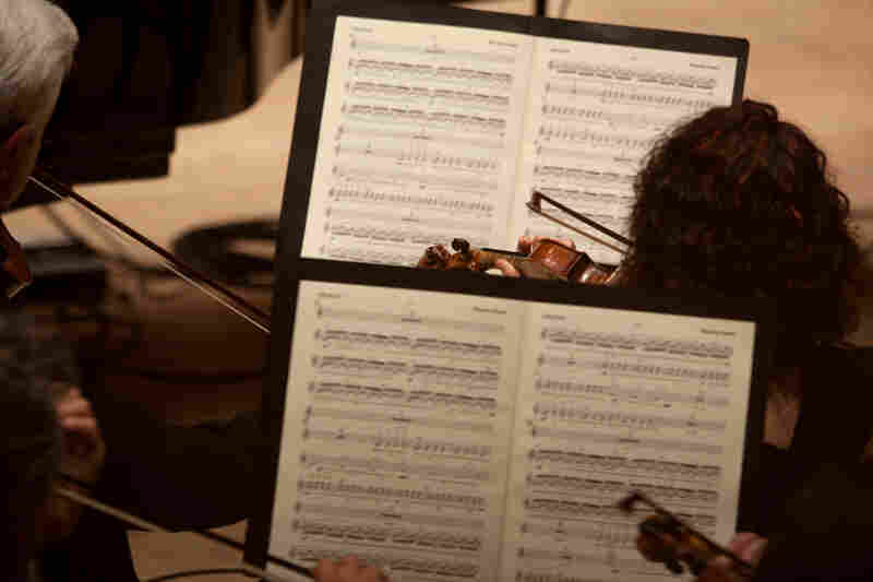 """Become Ocean is scored for large symphony orchestra, including four harps. Adams says the orchestra is deployed as three separate ensembles. """"It's really a piece for three orchestras,"""" he says. """"The different instrumental choirs are separated as widely as possible in the performance space."""""""