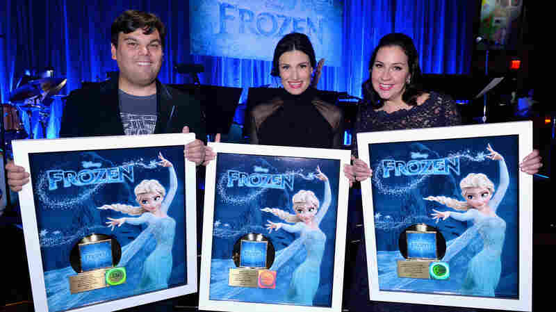 Singer Idina Menzel (center) and Frozen songwriters Bobby Lopez (left) and Kristen Anderson-Lopez pose with gold records in February. Since then, the movie's soundtrack has sold over 1.5 million more copies.