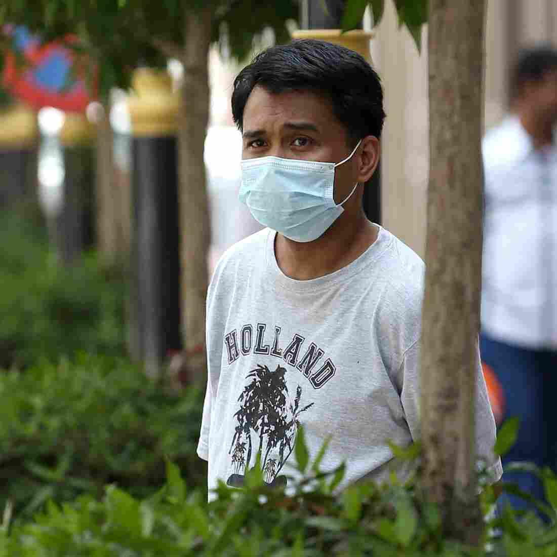 Fear of MERS is prompting Saudis to wear mouth and nose masks, like this man on the street of the Red Sea coastal city of Jeddah on April 27.