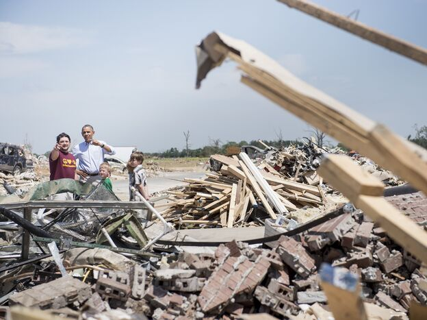 President Obama surveys tornado damage with Vilonia, Ark., resident Daniel Smith on Wednesday.