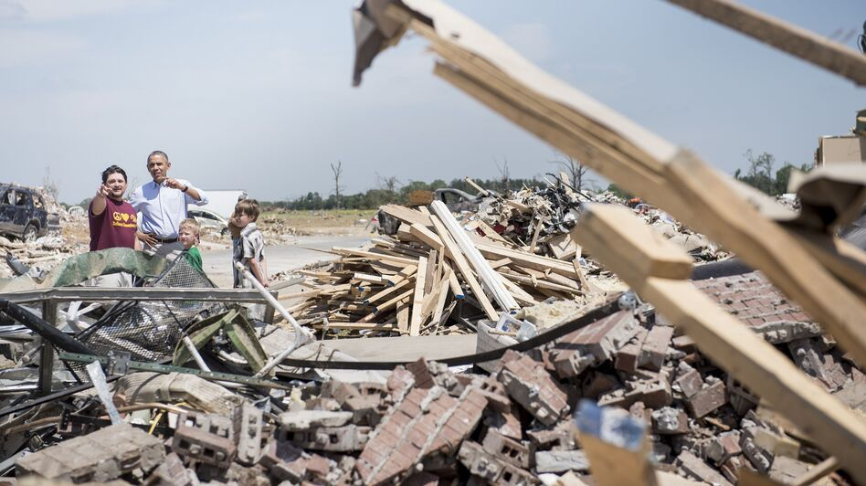 President Obama surveys tornado damage with Vilonia, Ark., resident Daniel Smith on Wednesday.