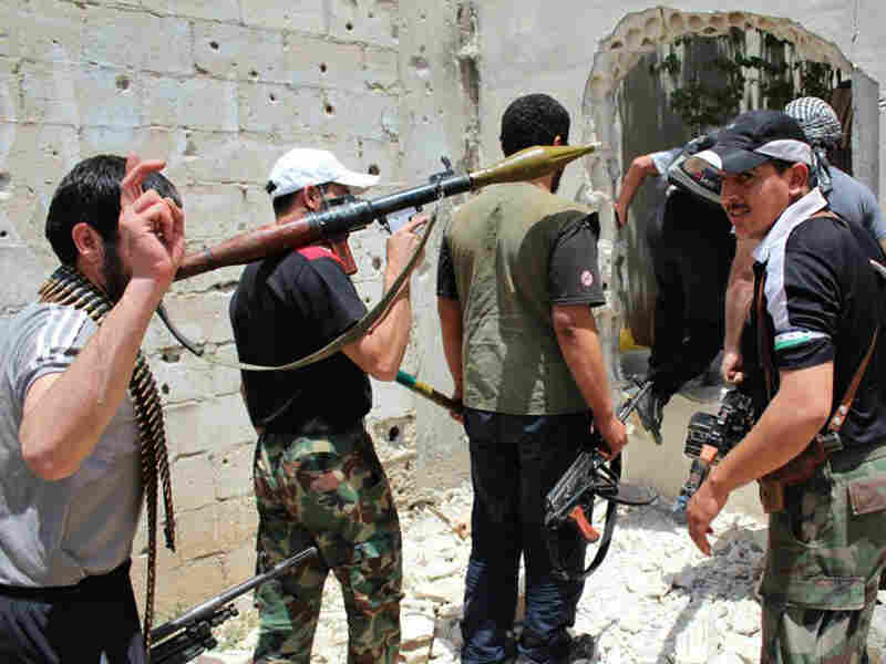 A photo from June 2012 shows Syrian rebels in Homs. The last of the insurgents were leaving the town on Wednesday under a cease-fire deal.