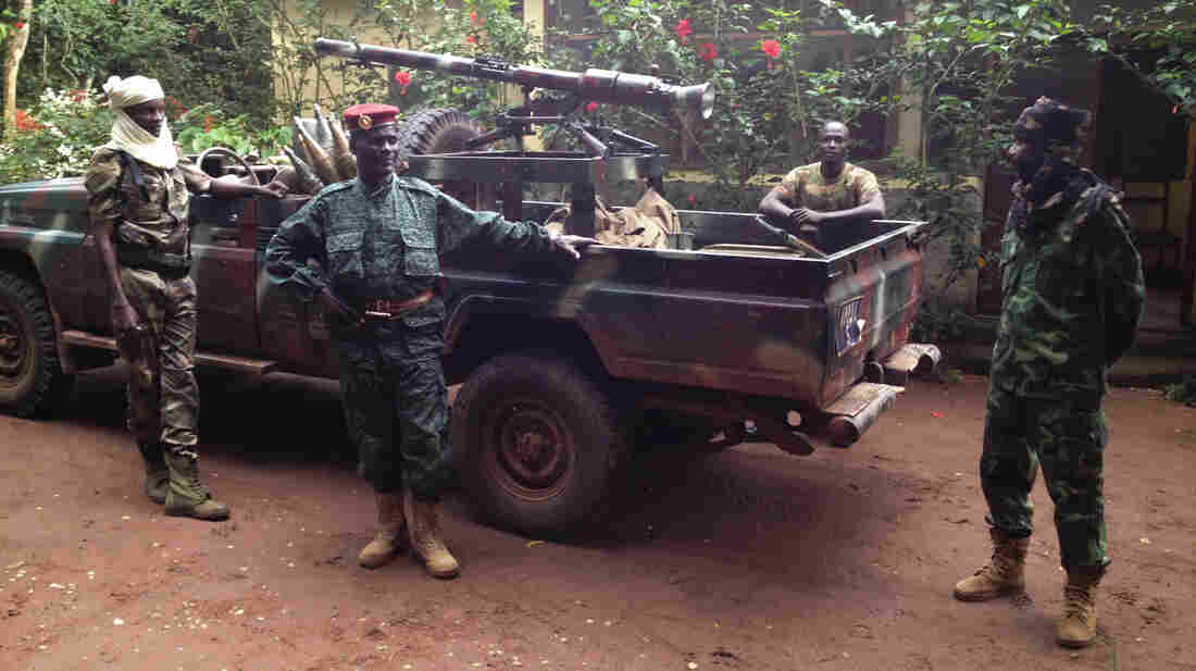 Col. Bahit, a former Seleka commander (center), and his entourage pose for a photo during Kalron's August 2013 visit to Bayanga, Central African Republic.