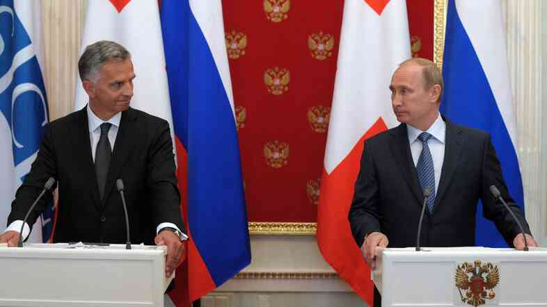 Russia's President Vladimir Putin, right, addressed the media Wednesday along with the head of the Organisation for Security and Cooperation in Europe (OSCE), Swiss President Didier Burkhalter.