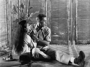 Actors John Kerr and France Nuyen in a scene from the 1958 film South Pacific. The interracial romance between the onstage pair unsettled some audiences.