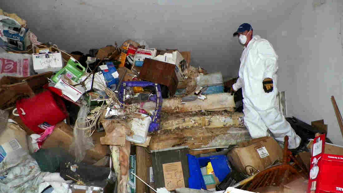 A worker cleans the home of a hoarder in Las Vegas. Teens may not have the time to accumulate this much stuff, but they still have symptoms.