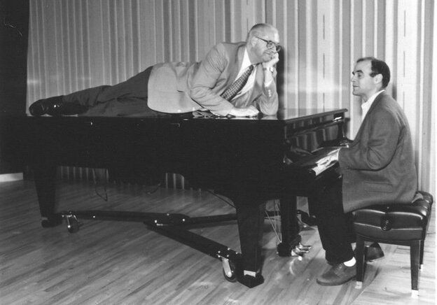 Carl decides to take a publicity photo shoot up a notch while Peter tickles the ivories.