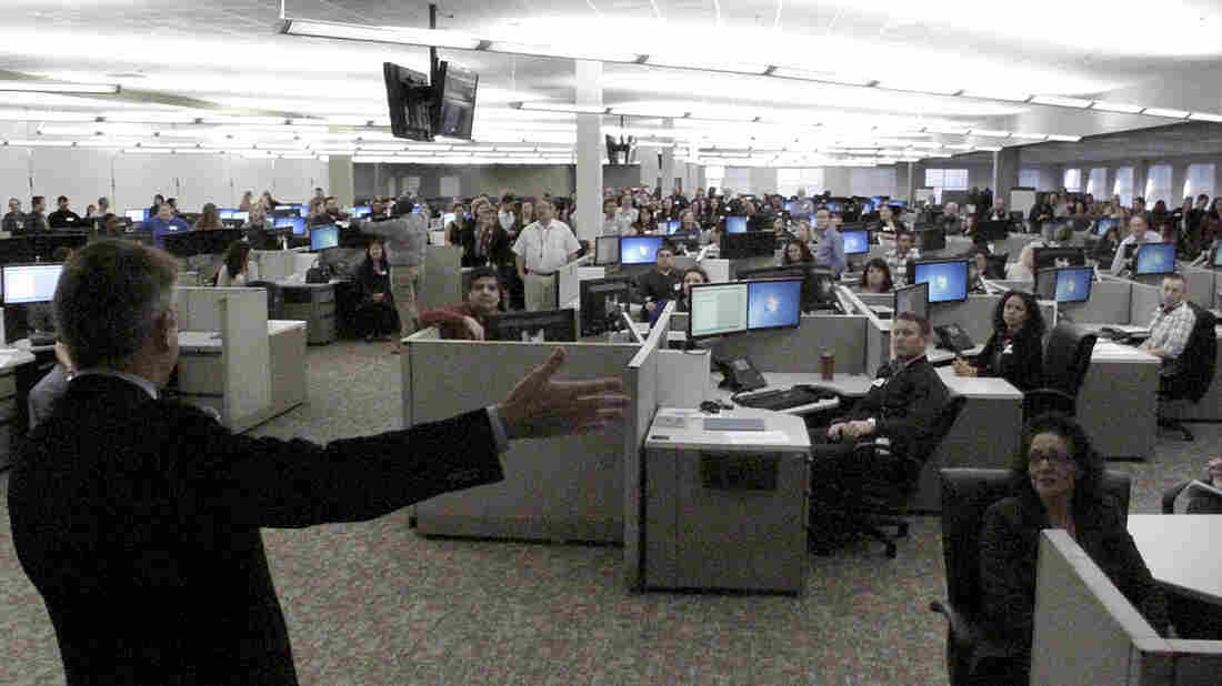 Peter Lee (left), executive director of Covered California, greets employees at a call center in Fresno, Calif., in February.