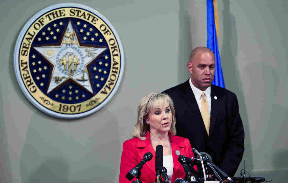 Republican Gov. Mary Fallin of Oklahoma, here with Michael C. Thompson, state secretary of safety and security, charged that the state Supreme Court had exceeded its jurisdiction  when it called for a stay of execution in the Clayton Lockett case in March.