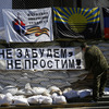 "Pro-Russian separatists say they'll hold a referendum Sunday on seceding from Ukraine, despite Russian President Vladimir Putin's comments that they should wait to hold the vote. Thursday, a gunman installs a banner reading ""Do not forget, do not forgive!"" in eastern Ukraine."