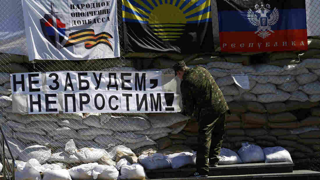 """Pro-Russian separatists say they'll hold a referendum Sunday on seceding from Ukraine, despite Russian President Vladimir Putin's comments that they should wait to hold the vote. Thursday, a gunman installs a banner reading """"Do not forget, do not forgive!"""" in eastern Ukraine."""