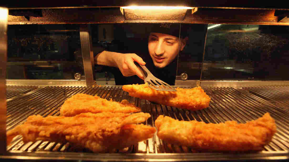 Fried cod awaits its destiny as fish and chips in London.