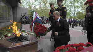 President Vladimir Putin lays flowers during a ceremony marking Victory Day in the Crimean city of Sevastopol on Friday. It was his first visit to the region since Russia annexed it in March.