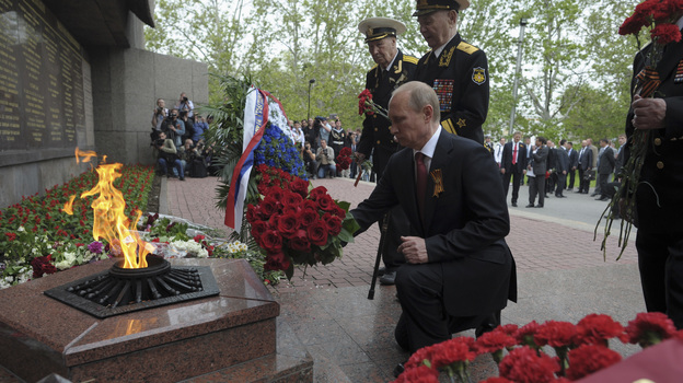 President Vladimir Putin lays flowers during a ceremony marking Victory Day in the Crimean city of Sevastopol on Friday. It was his first visit to the region since Russia annexed it in March. (Reuters/Landov)