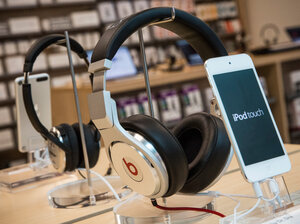 Beats headphones are sold alongside iPods in an Apple store in New York City. Apple is reportedly considering buying Beats for more than $3 billion.