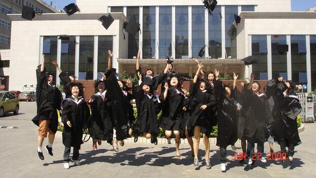 The author's classmates celebrate during graduation at Minzu University of China in Beijing, China, in June 2009.