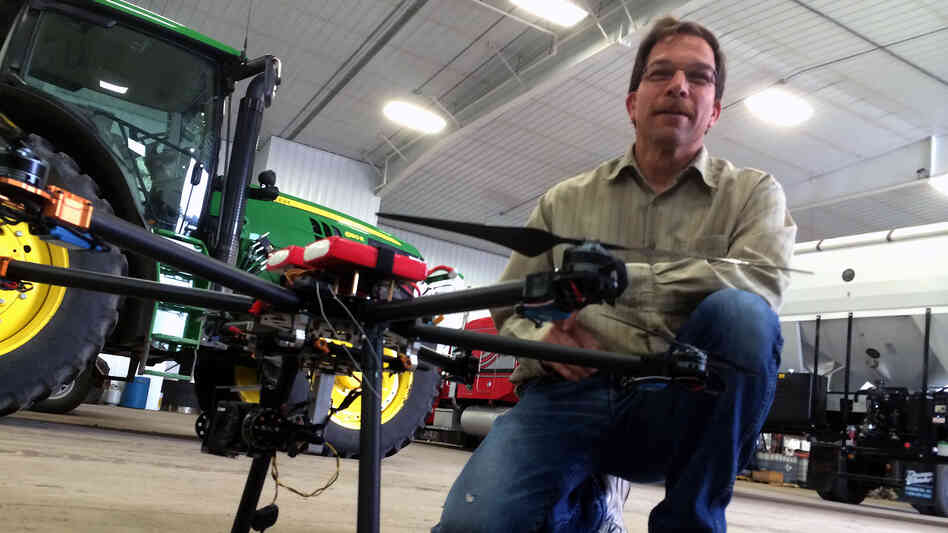 North Dakota farmer Jim Reimers shows off one of the drones he uses to collect data on his family's 30,000-acre farm.