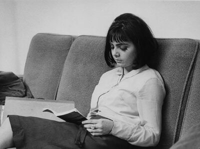 A student buries herself in a book in the Shaw Library at the British Library of Political and Economic Science in 1964.