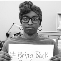 Di-Tu Dissassa posted an Instagram photo of herself holding a sign with the hashtag #BringBackOurGirls.